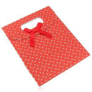 Pungă de cadou din hârtie roșie cu buline albe, fundă roșie imagine